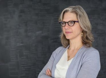 Pamela Klassen in front of chalkboard